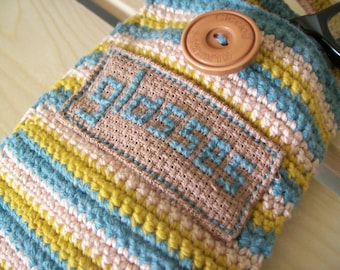 Crocheted glasses case- eyeglasses,cross stitch, yellow, pink, teal green with a light brown button (biscuit button)