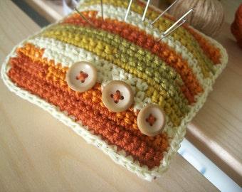 Crochet pincushion, romantic autumn, orange, light yellow, green, with light brown buttons