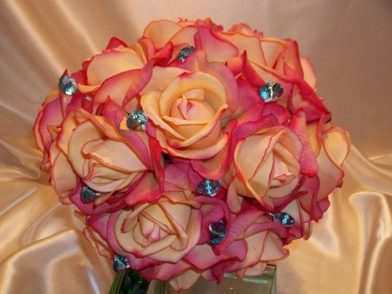 Shades of Coral Real Touch Roses Wedding Bouquet with Either Large or Smaller Teal Crystal Accents and Satin Hand Tied Stems.
