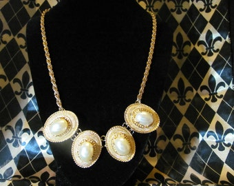 Roman Classical style four shield shapes with large faux pearls in Gold metal settings and chain