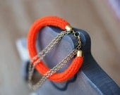 Neon orange knit wool bracelet with double gold plated chain