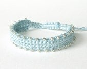 Beaded friendship bracelet, crocheted in pale baby blue with adjustable knot & silver plated heart tag 'Made with Love'