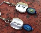 Silver Laugh and Smile Blue Ladybug Dangle earrings