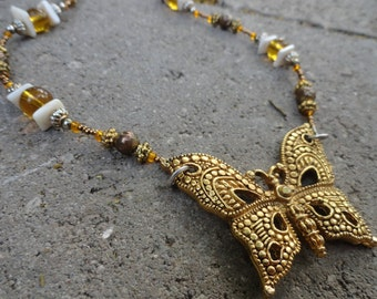 Gold Tint Metal Butterfly Necklace with Shell  and Metal Bead Accents