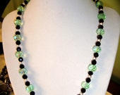 Green glass and black necklace