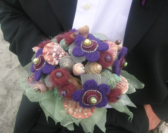 Purple and green felted flower and seashell bridal bouquet and boutonniere