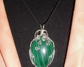 Malachite oval cabochon wire wrapped pendant in sterling silver
