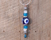 Sparkly Blue Evil Eye Pendant The Golden Globes Party Collection