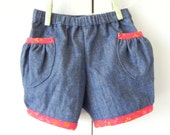 Toddler girl's denim bloomer shorts with red trim