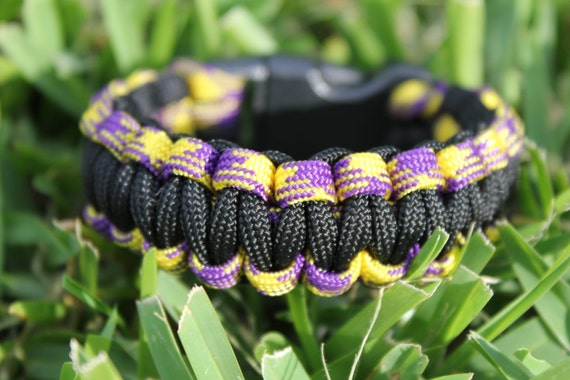 Paracord Survival Bracelet - Black, Purple and Gold/Yellow with Black Slide Release Clip (LSU)