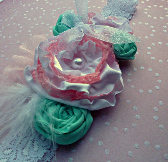 Mermaid Baby Girl Headband- a soft pink and white flower with mint green rosettes, pearls and feathers