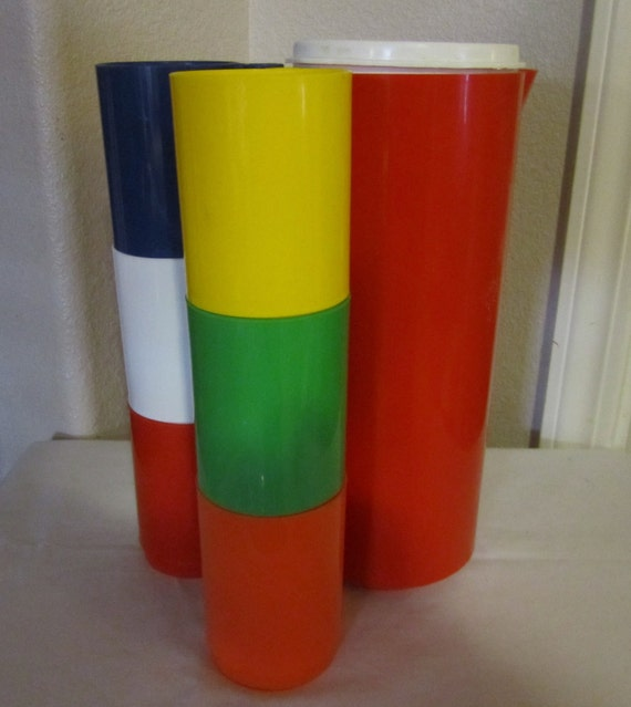 Vintage plastic pitcher with attached tumblers
