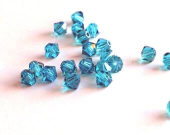 4mm Zircon Swarovski bicone beads (x24)