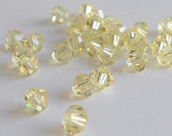 4mm Jonquil Swarovski bicone beads (x12)
