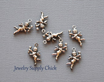 Silver ox cherubs (x4)