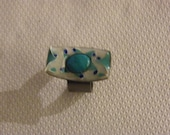 Enamel ring with a turquoise gemstone