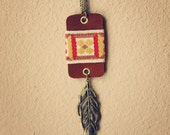 camille.  a long boho suede and feather necklace.