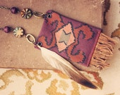 laura.  a bohemian vintage ikat fringe and feather necklace.