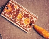 mandarin.  an orange and rust vintage embroidered trim necklace.