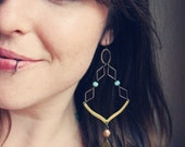 maya. a pair of green and gold mixed metal geometric earrings.