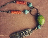 sioux. a colorful beaded brass feather necklace.