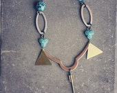 zuni. a native geometric teal and arrow necklace.