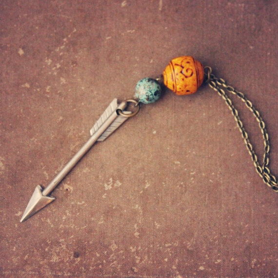 mercedes.  a beaded silver arrow necklace in orange and teal.