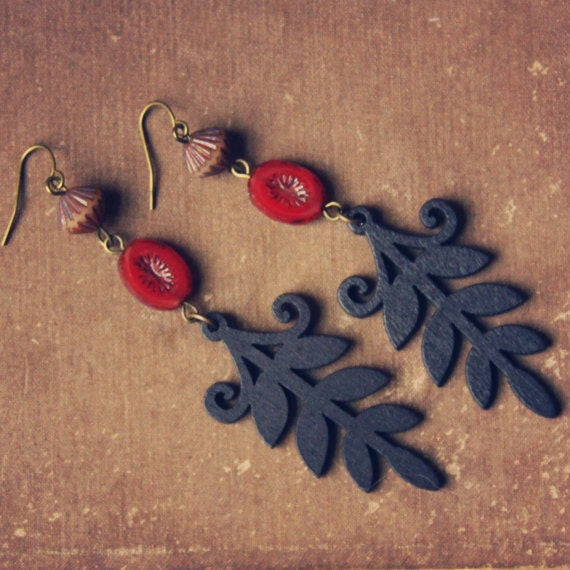 jamelia.  a pair of beaded black and ruby wooden leaf earrings.
