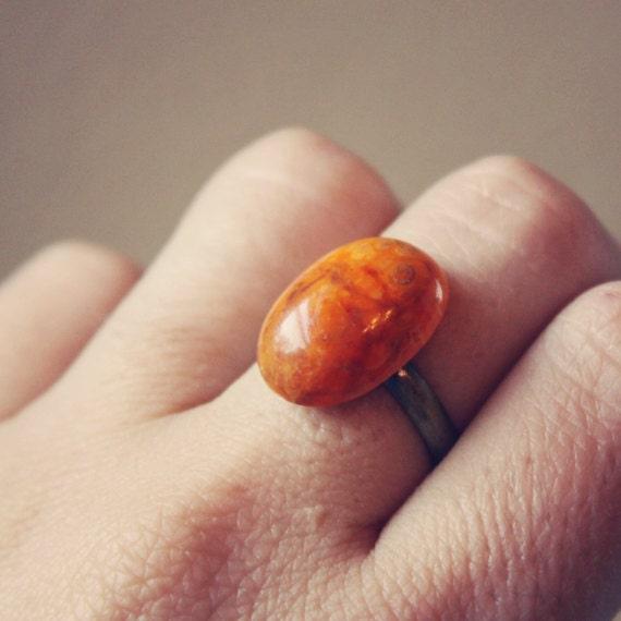 sina.  a petite orange marbled cab ring.