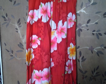 Hawaiian dress in red with large hibiscus flower design