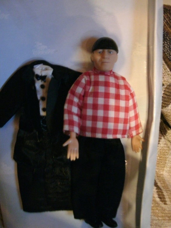 Mo doll from the three stooges,  with a extra suit