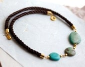 Turquoise Stone and Brown Cord Necklace by pardes israel