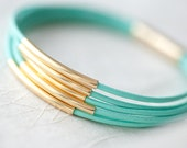 Resreved for Monica T: Mint Green Leather Bracelet with 6 Golden tubes by pardes israel