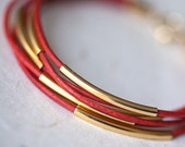 Coral Leather Bracelet with 6 Golden tubes by pardes israel