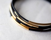 Black  Leather Bracelet with 6 Golden tubes by pardes israel