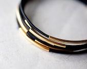 Black  Leather Bracelet with 6 Golden tubes by pardes israel