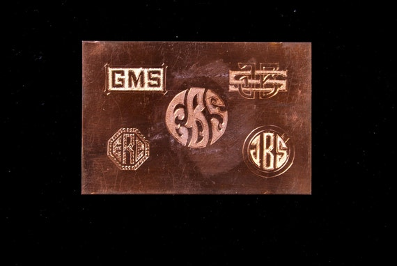 Engraved monograms on copper .