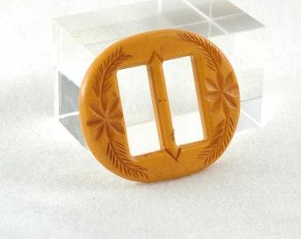 vintage yellow/orange carved bakelite buckle