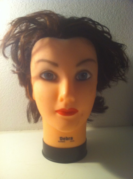 A rubber & styrofoam mannequin head with real human hair.