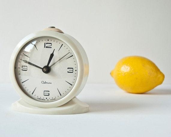 Vintage white mechanical alarm clock Sevani, Soviet Era