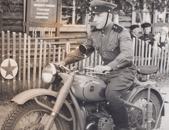 Vintage Soviet army photo, soldier on  motorcycle