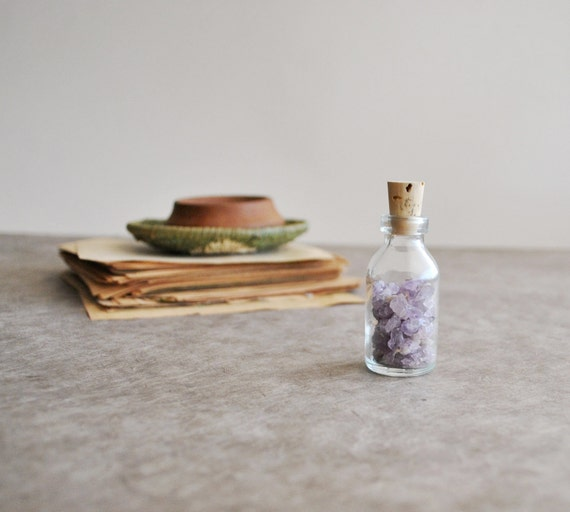 tiny amethyst pieces in a small bottle, amethyst from thunder bay, canada