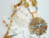 Beaded Crystal and Gold Toned Necklace, Bracelet and Earring Set