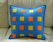 patchwork pillow- blue, orange and golden yellow