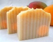 Mango Orangesicle enriched with mango, shea & avocado butters, plus orange peel