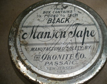 really cool vintage chippy rusted shabby old tin.. the Okonite co manson tape ..