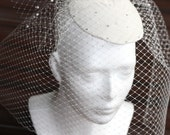 BIRDCAGE VEIL. Fascinator adorned fantastic  flower, crystals and  feathers