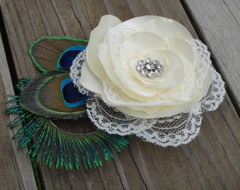 Bridal ivory satin lace flower hair clip accented with a rhinestone, peacock eye and sward feathers
