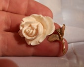 Pre Ban Ivory Rose carved Brooch. 14 kt gold filled setting. West German. Made by Wells. Hallmarked. Great condition.