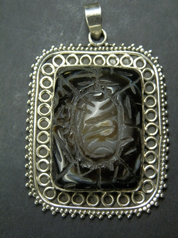Vintage 925 Silver and Dark carved Agate Ornate Pendant.